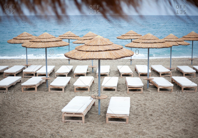 Parasols and loungers on beach
