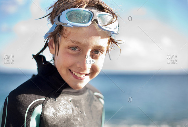 Portrait of boy in wetsuit and goggles