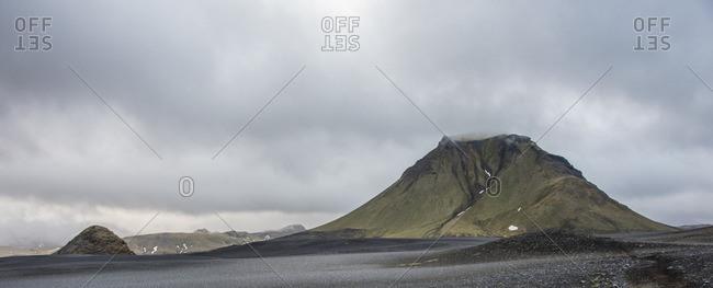 Barren mountaintop under clouds