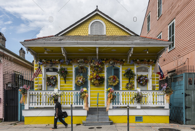 New Orleans, Louisiana - June 6, 2016: Person passing typical New Orleans house