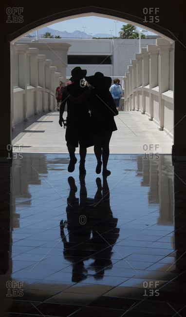 June 14, 2016: Couple walking at entrance to tunnel