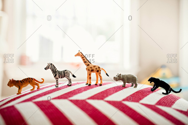Animal toys lined up on pillow