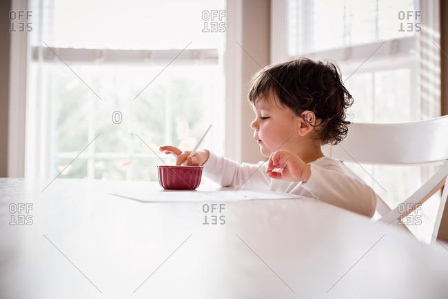 Little boy using watercolor paint