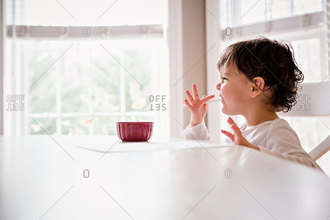 Little boy tasting watercolor paint