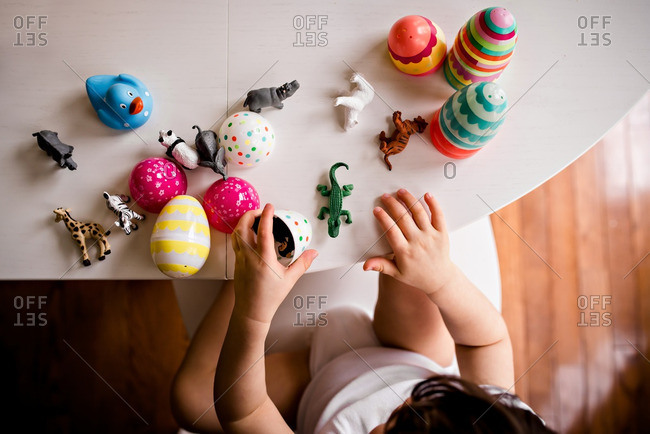 Boy with toys and Easter eggs