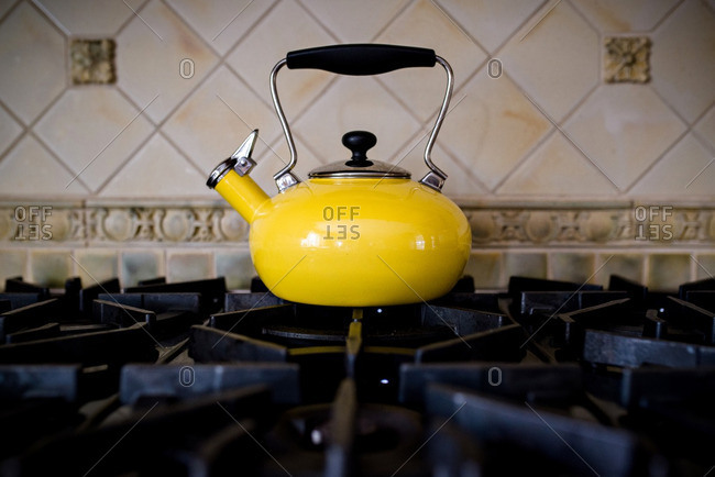 A tea kettle on stove top