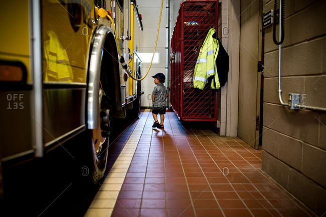 Boy wandering in fire station