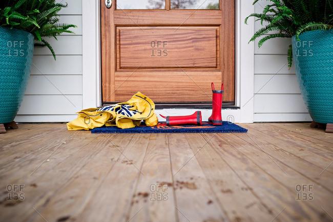 Rain clothing left by front door