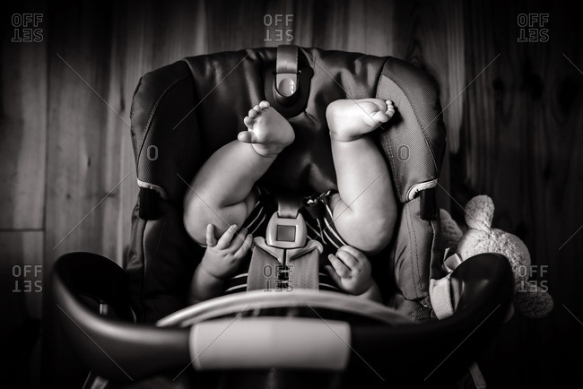 A baby in a portable car seat
