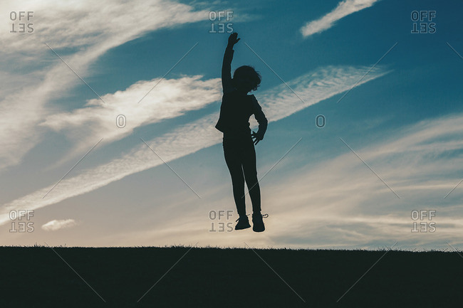 Child leaping in silhouette