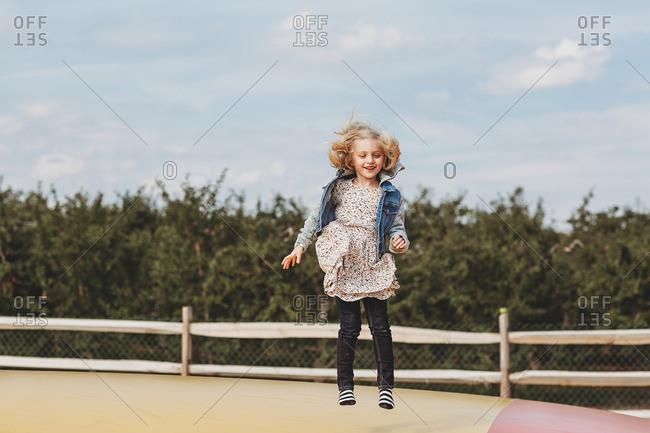 Blonde girl in midair leap