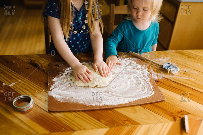 Girls making biscuit dough