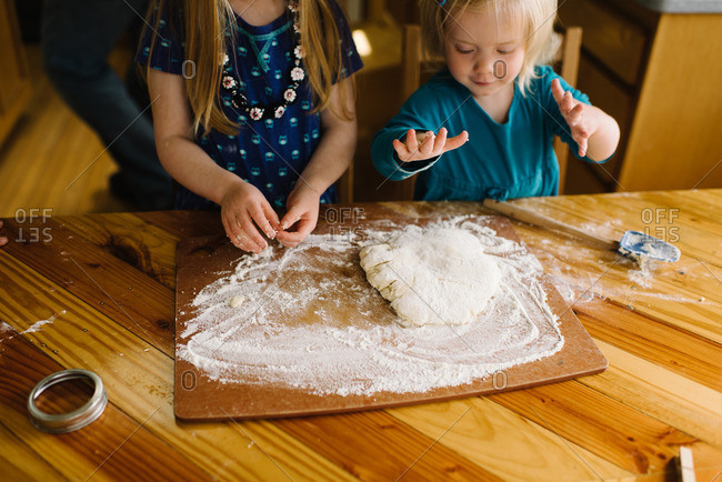 Girls preparing biscuit dough