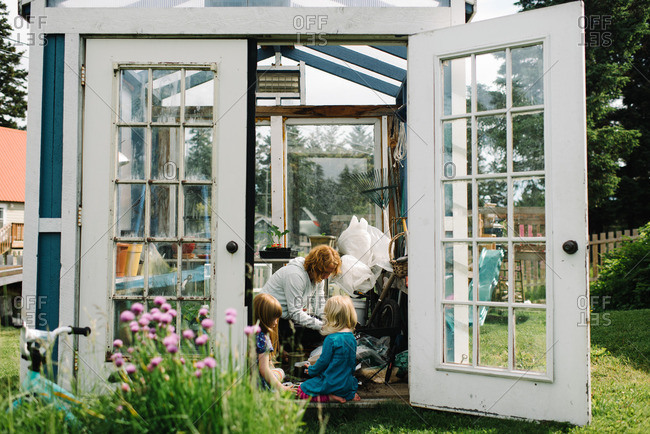 Girls and mom in their greenhouse