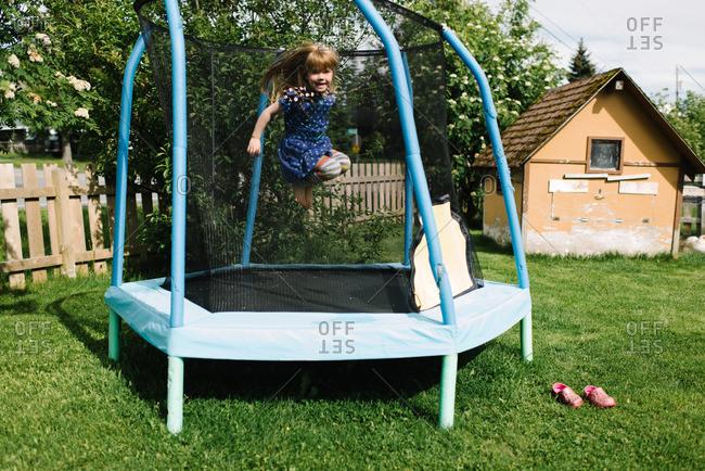 Girl inside a trampoline