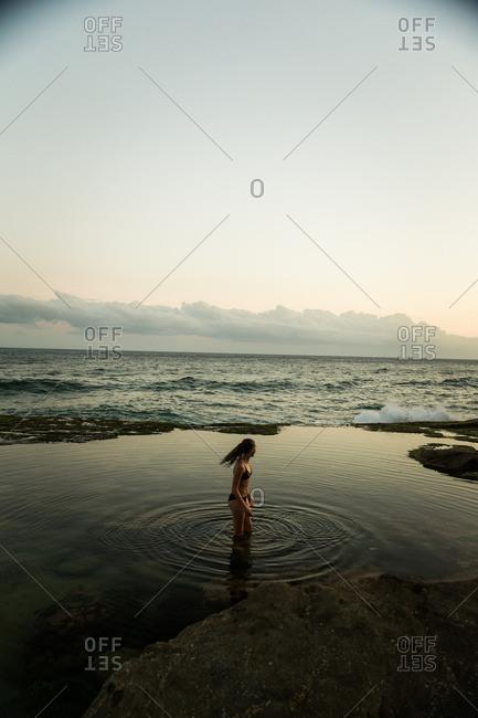 Woman making ripples in tide pool