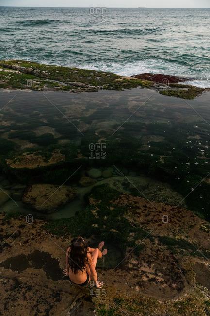 Woman relaxing in ocean tide pool