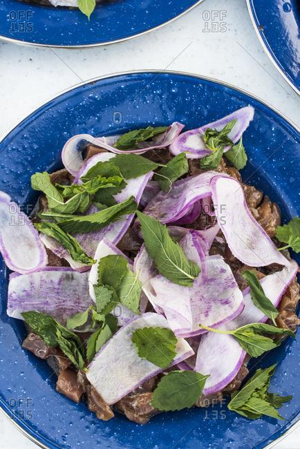 Dish with Daikon radish, marinated tuna and mint leaves