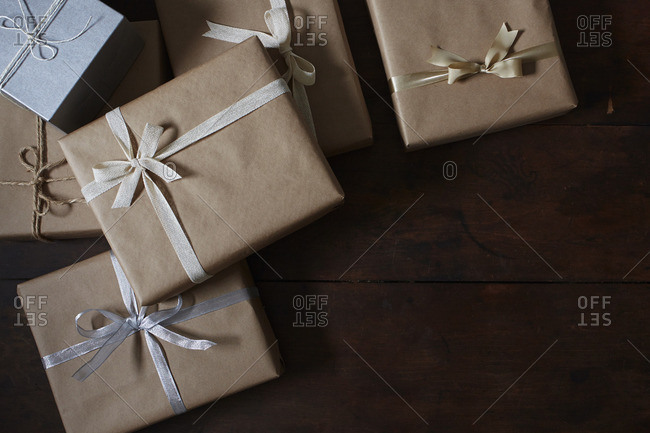 Many gift boxes wrapped in brown paper and tied with ribbon