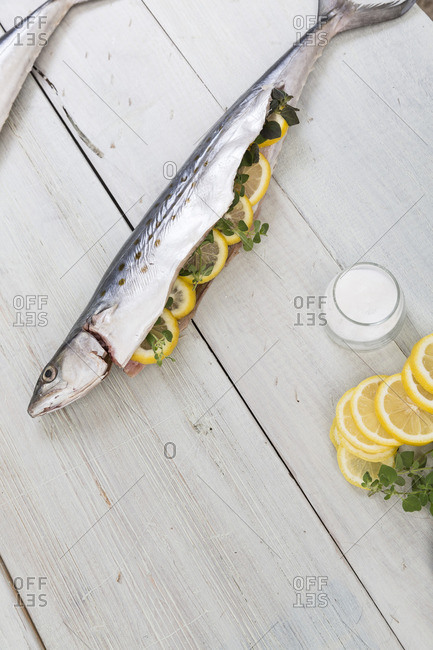 Raw fish stuffed with lemon slices and herbs