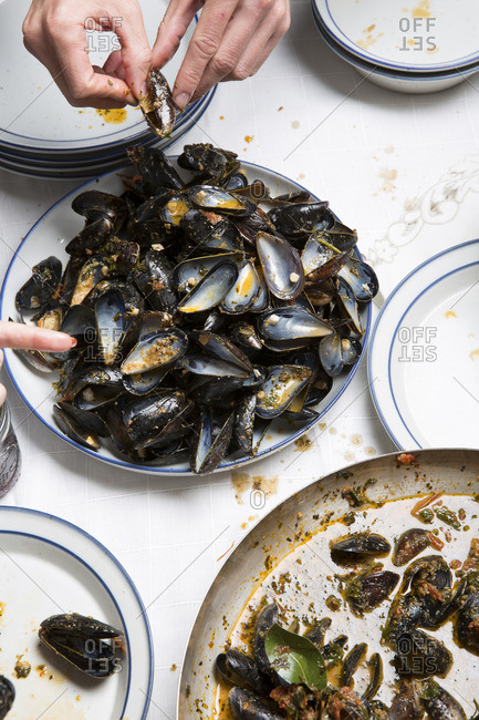 High angle view of eating mussels