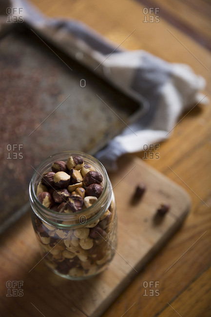 High angle view of toasted hazelnut in jar
