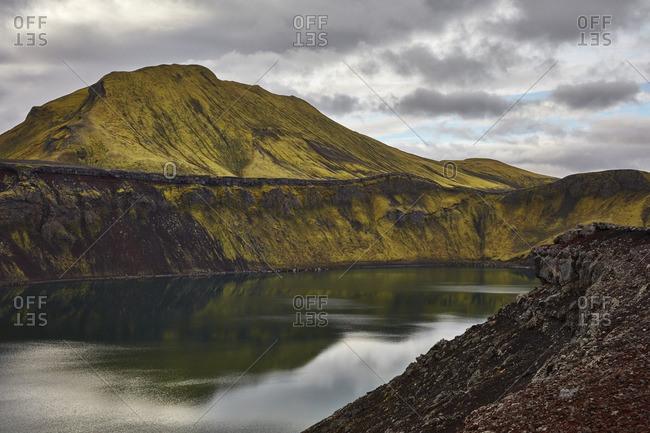 Lake nestled in rural mountains, Iceland