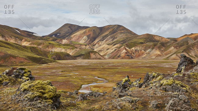 Mossy valley in mountain landscape, Iceland
