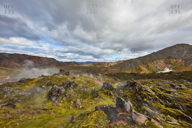 Geothermal steam over Icelandic mountains