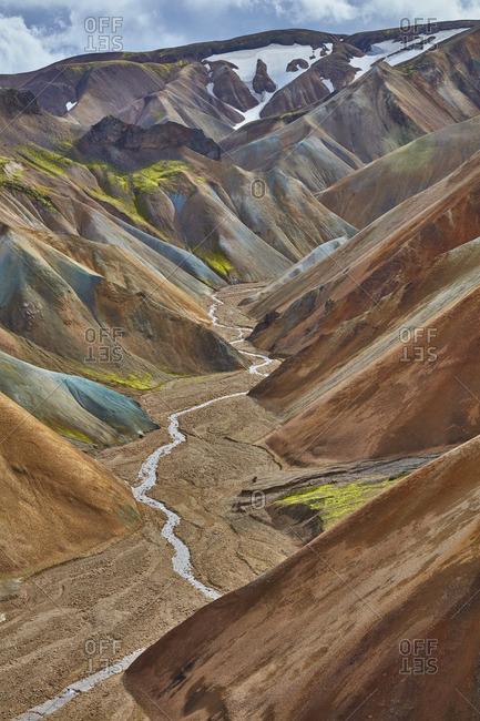 River running through mountain range, Iceland