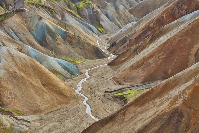 River running down mountain range, Iceland