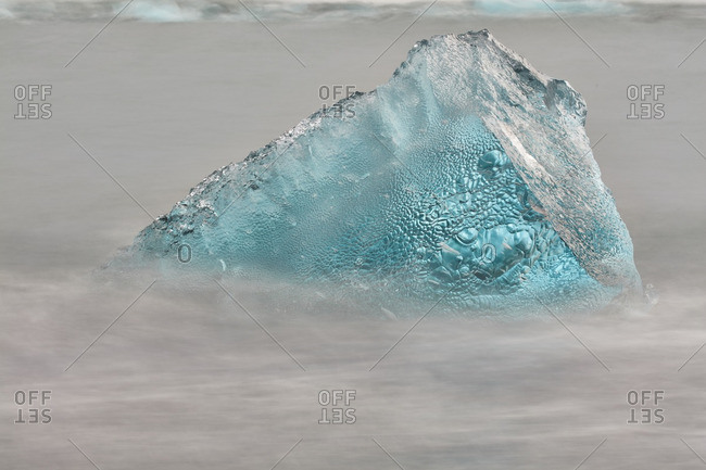 Chunk of ice on rocky beach in Iceland