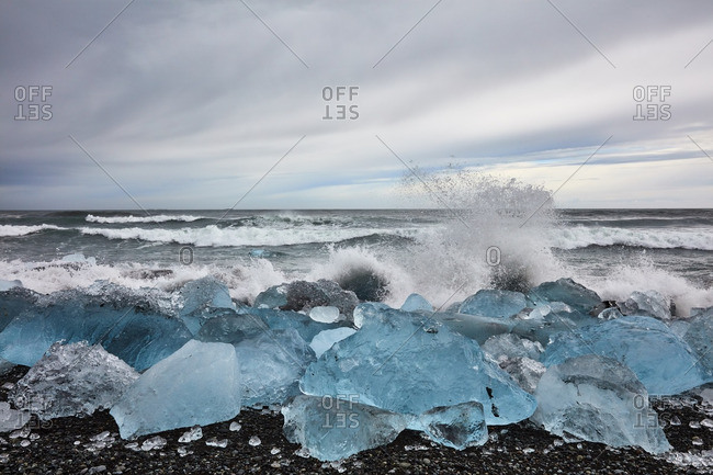 Waves splashing at glacial shore, Iceland