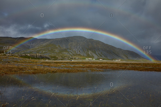 Double rainbow over rural Iceland setting