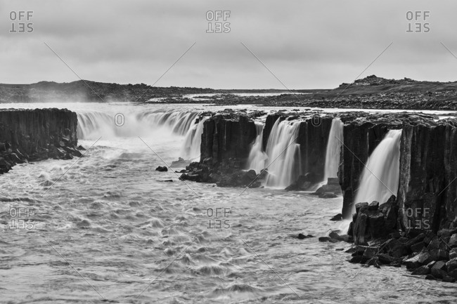 Cascades over basalt cliffs, Iceland