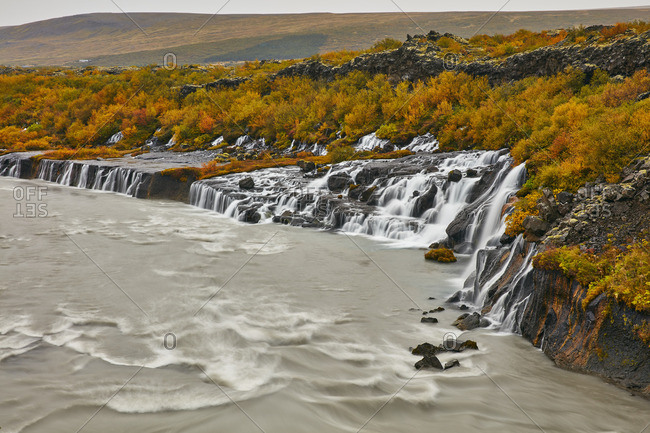 Water flowing down hills to river in Iceland