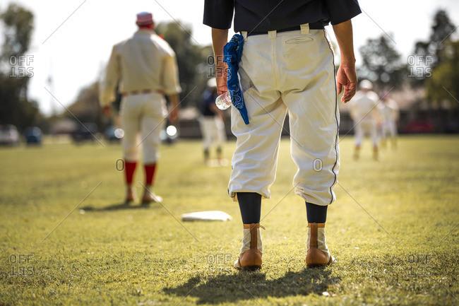 Men playing baseball in old uniforms