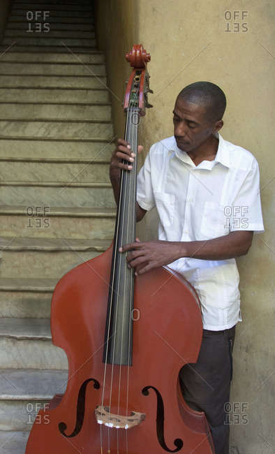 Havana, Cuba - January 25, 2010: Bass player in a stairway