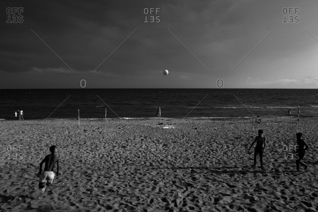 Terracina, Italy - August 5, 2016: Young men playing football on the beach