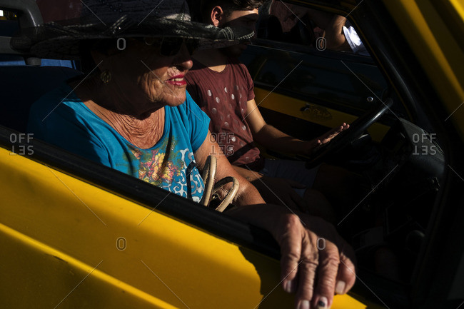 Ponza, Italy - August 4, 2016: Tourist in a yellow taxi