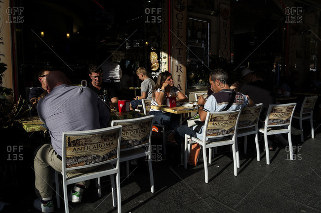 Rome, Italy - October 15, 2106: Tourists dining at outdoor caf�