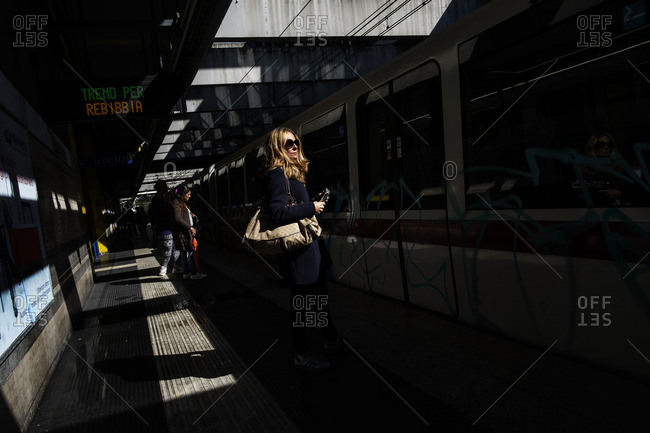 Rome, Italy - October 7, 2016: People waiting in the metro station