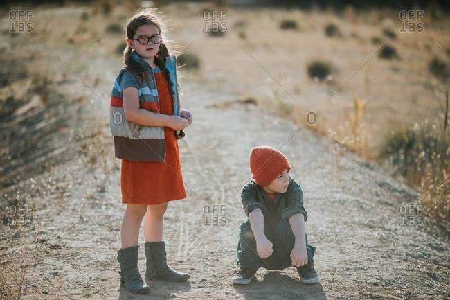 Portrait of siblings on dirt road