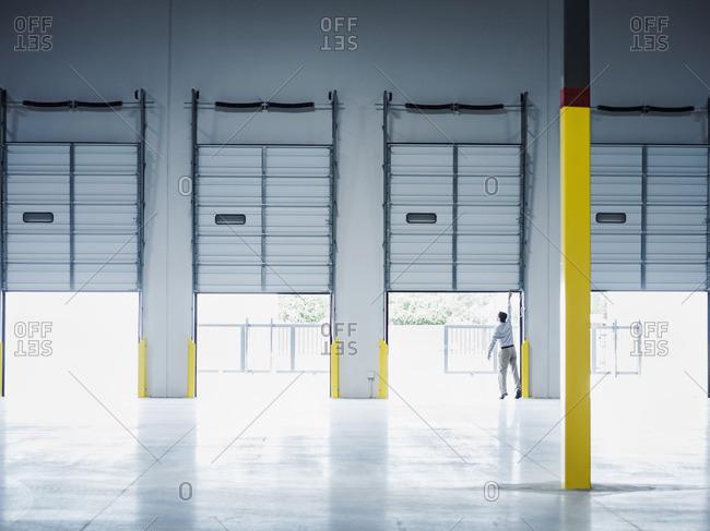 Caucasian businessman lifting loading dock door