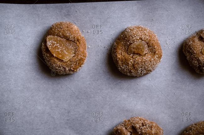 Vegan ginger molasses cookies on baking sheet