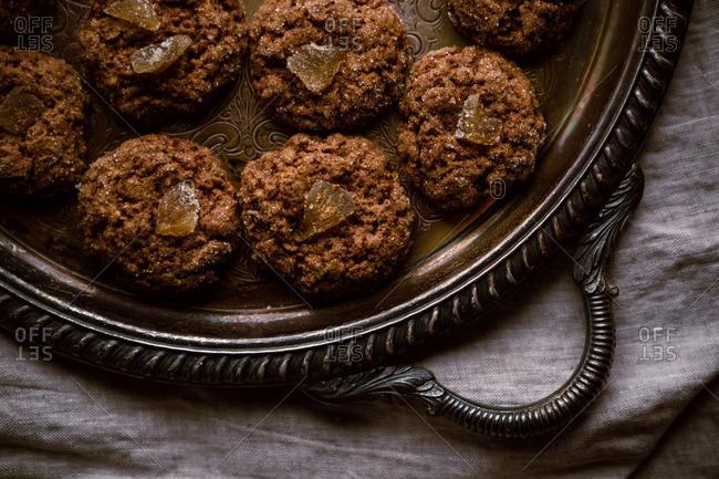 Vegan ginger molasses cookies on rustic plate