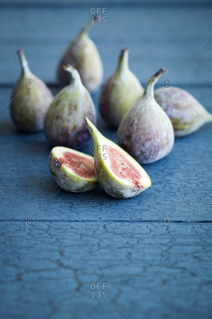 Fresh figs on blue background