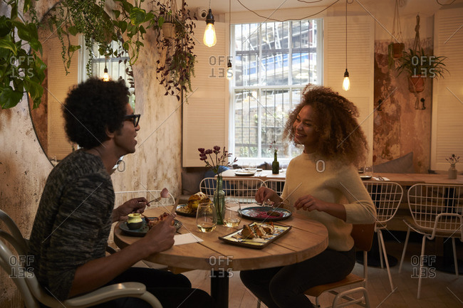 Young couple enjoying meal on date in restaurant