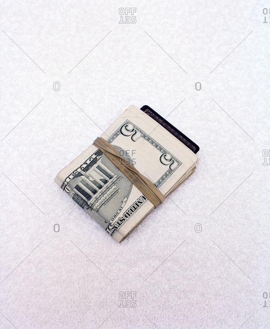 Bundle of cash held together with a rubber band