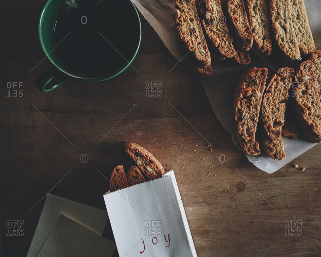 Fresh baked biscotti on parchment paper and in a gift bag